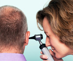 Doctor Performing an Audiology Examination